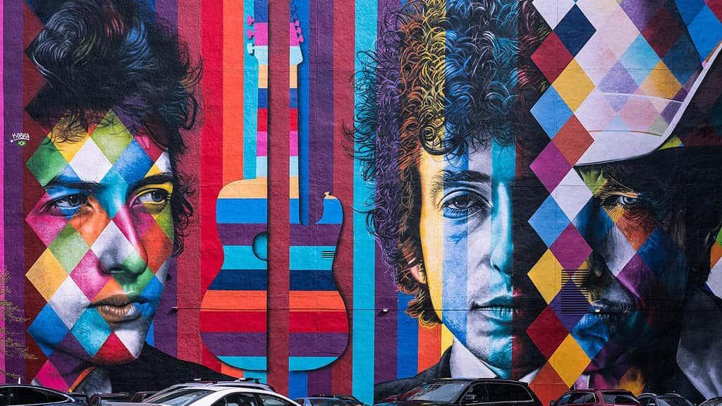 1280px-Bob_Dylan_Mural,_Minneapolis_(34397870216)By Sharon Mollerus